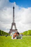 Loving couple smiling near the Eiffel Tower in Paris. Lovers smiling in Paris with the Eiffel Tower in the Background Stock Photo