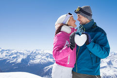 Loving couple on snow stock images