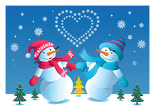 Loving couple of snowmen Stock Photography