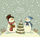 Loving couple of snowmen with gifts beside Royalty Free Stock Photo