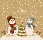 Loving couple of snowmen with gifts beside Royalty Free Stock Photos