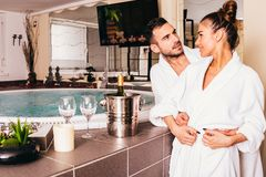 Loving couple in spa center. Loving young couple in spa center royalty free stock photography