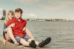 Loving couple spending leisure time together at seaside Royalty Free Stock Images