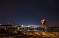 Loving couple standing against a background of the night sky royalty free stock images