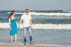Loving couple standing on the beach at the day time. Royalty Free Stock Image