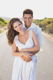Loving couple standing on countryside road Royalty Free Stock Images