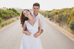 Loving couple standing on countryside road Royalty Free Stock Photography