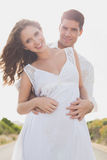 Loving couple standing on countryside road Stock Photos