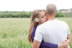 Loving couple standing in the field Royalty Free Stock Image
