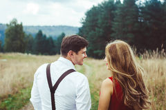 Loving couple standing on a forest road stock images