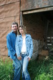 Loving Couple. Standing in front of an old farm building Stock Image