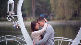 Loving couple standing in the gazebo in the form of heart. In the park. Valentine's Day stock video