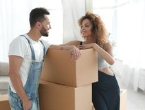 Loving couple standing next to boxes. When moving to a new house Stock Photography