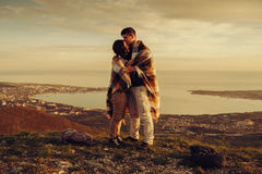 Loving couple standing outdoor at sunset Stock Photo