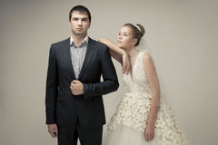 Loving couple standing in the studio Royalty Free Stock Photos