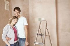 Loving Couple Standing In Unrenovated Room Stock Image