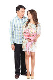 Loving couple standing on white background. Royalty Free Stock Photo