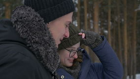 A loving couple standing in the woods stock footage