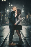 Loving couple in the street at night Royalty Free Stock Image