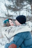 Loving couple on street in winter royalty free stock photography