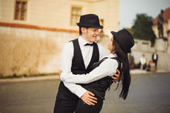 The loving couple is in a street Stock Images