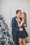 Loving couple in the studio Christmas Royalty Free Stock Image