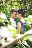 Loving couple in summer sunny park Royalty Free Stock Photo