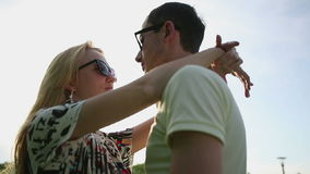 Loving couple in sunglasses at sunset slow motion.  stock video footage