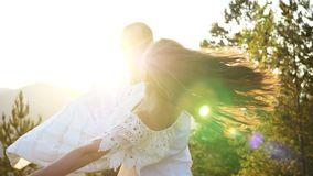 Loving couple at sunset. The guy hugs the girl. Face to face. Love and romance. Young and happy.  stock footage