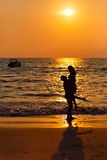 Loving couple  at sunset in the sea. The loving couple walks at sunset in the sea Stock Photos