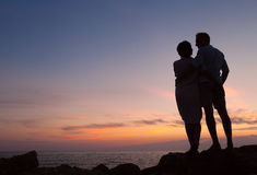 Loving couple sunset silhouette Stock Photo