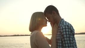 Loving couple at sunset stock video footage
