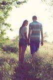 Loving couple at sunset. Walking loving couple at sunset Royalty Free Stock Photography