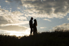 Loving couple at sunset Stock Photography