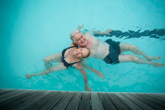Loving couple swimming in pool Royalty Free Stock Photo