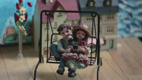 Loving couple on a swing. Puppet theater loving couple on a swing close to