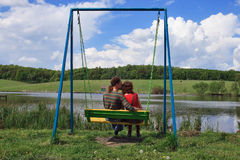 Loving couple on swings Royalty Free Stock Photos