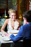 Loving couple at a table in restaurant Royalty Free Stock Images