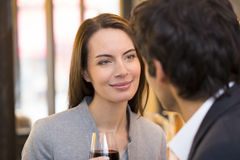 Loving couple takes a drink in restaurant stock image