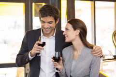 Loving couple takes a drink in restaurant Stock Photography