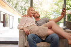 Loving couple taking a self portrait at home Stock Image