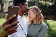 Loving couple taking selfie royalty free stock photography
