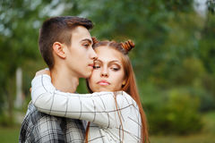 Loving couple teens embrace. Girlfriend and boyfriend together. Close-up. First love. He falls in love. Date Stock Photo