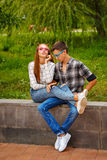 Loving couple teens. Girlfriend and boyfriend together. They wear glasses. First love. He falls in love. Date Royalty Free Stock Photo