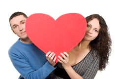 Loving couple tenderly holding heart Royalty Free Stock Photo