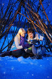 Loving couple in a tent drinking tea in winter Royalty Free Stock Photos