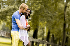 Loving couple by tge fence Stock Photography