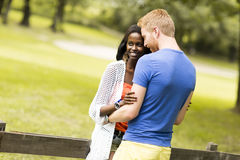 Loving couple by tge fence Stock Photos