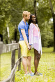 Loving couple by tge fence Royalty Free Stock Photography