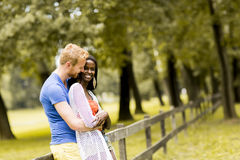 Loving couple by tge fence Royalty Free Stock Images